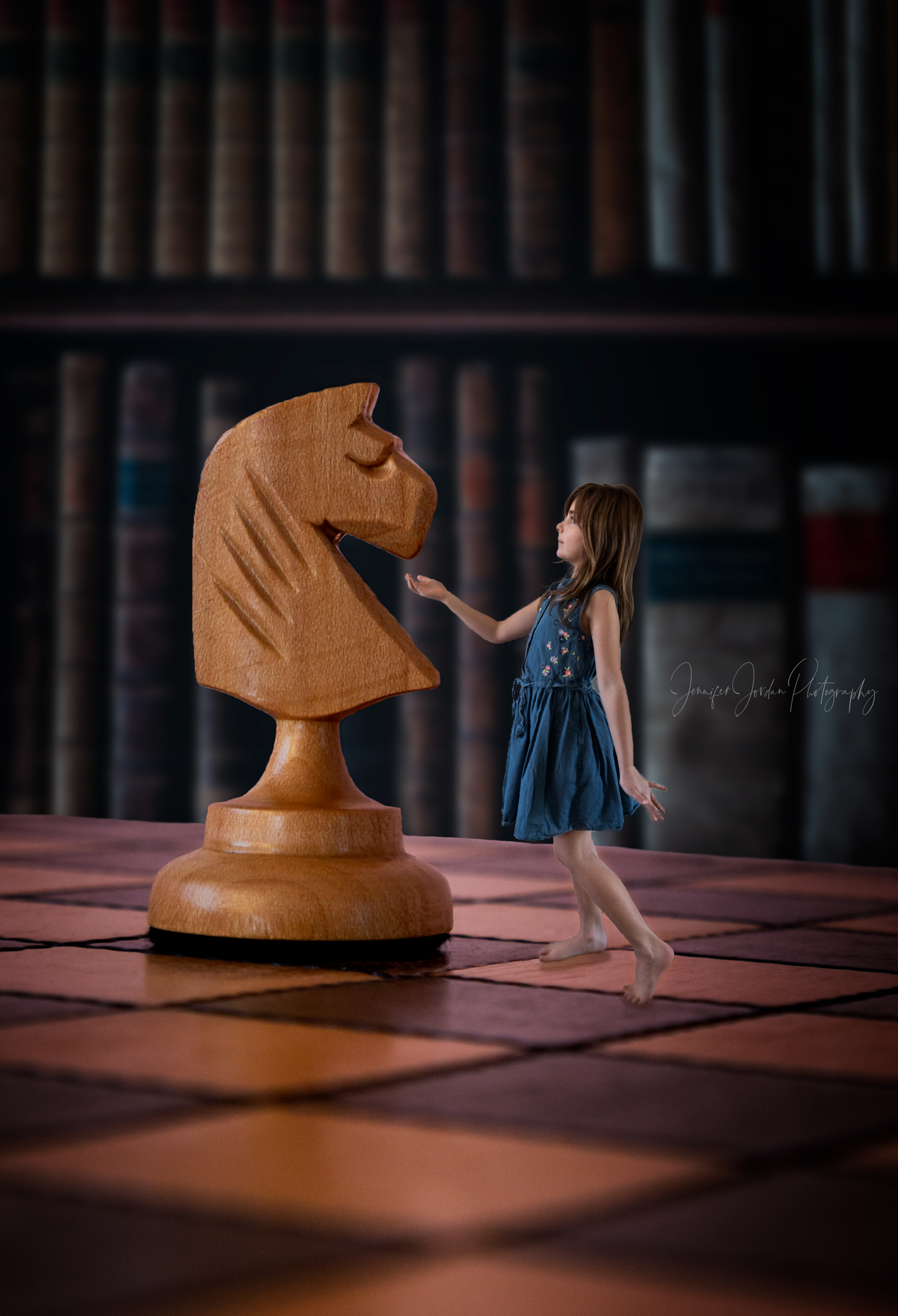 Creative imagery by Jennifer Jordan Photograph. Little girl reaches out to knight chess piece.